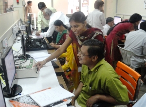 Ms. Pujari and other M.Sc. students explaining  CPLD practicals